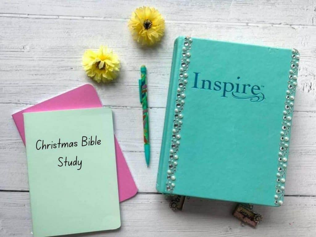 Inspire Bible and notebook with the words Christmas Bible study