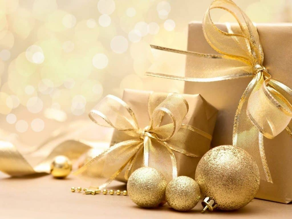 gifts wrapped in gold against a gold background